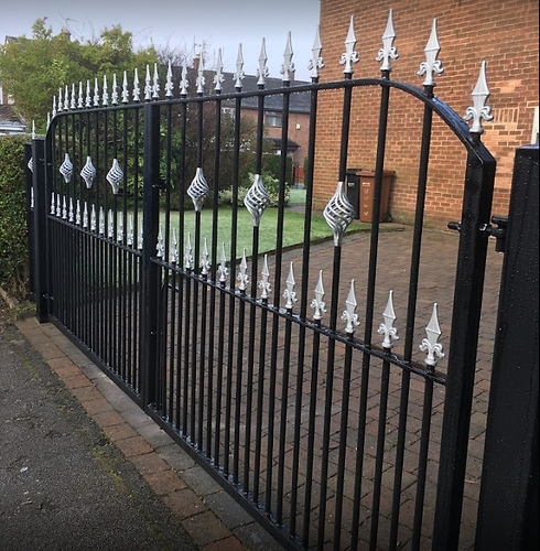 gate with silver spikes.PNG