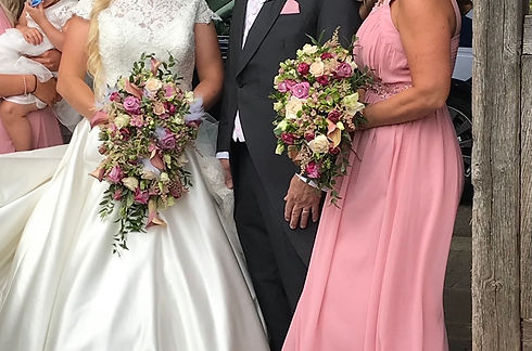 bride holding flowers on their wedding day.jfif