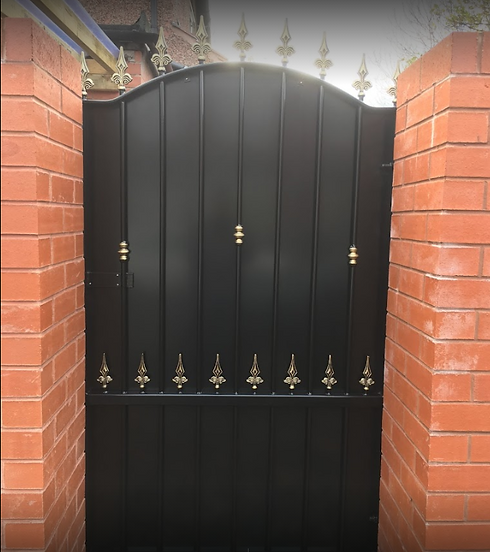 black gate with gold decorations.PNG