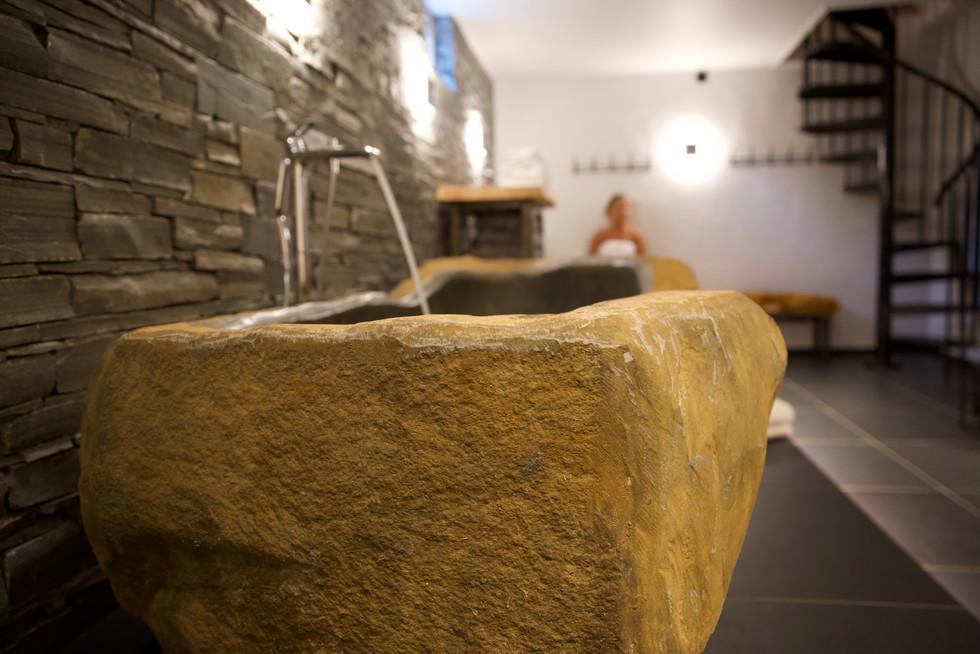 Bath tub carved in stone