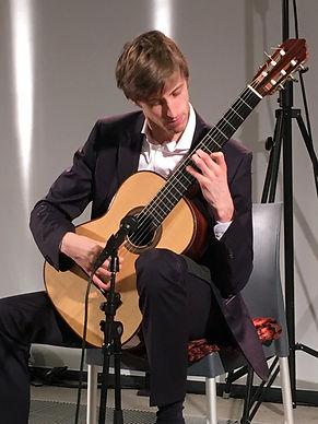 Maarten Vandenbemden with guitar.jpg