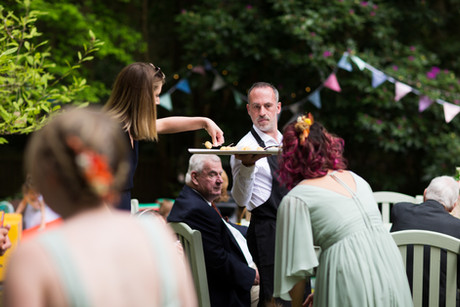 leah and alex serving cheese canapes 2.jpg