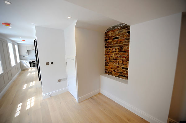 Listed building lounge with brick feature wall