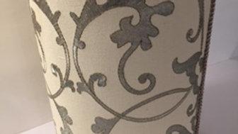 Jan Sevadjian wastebasket in elegant grey on ivory fabric with taupe trim.