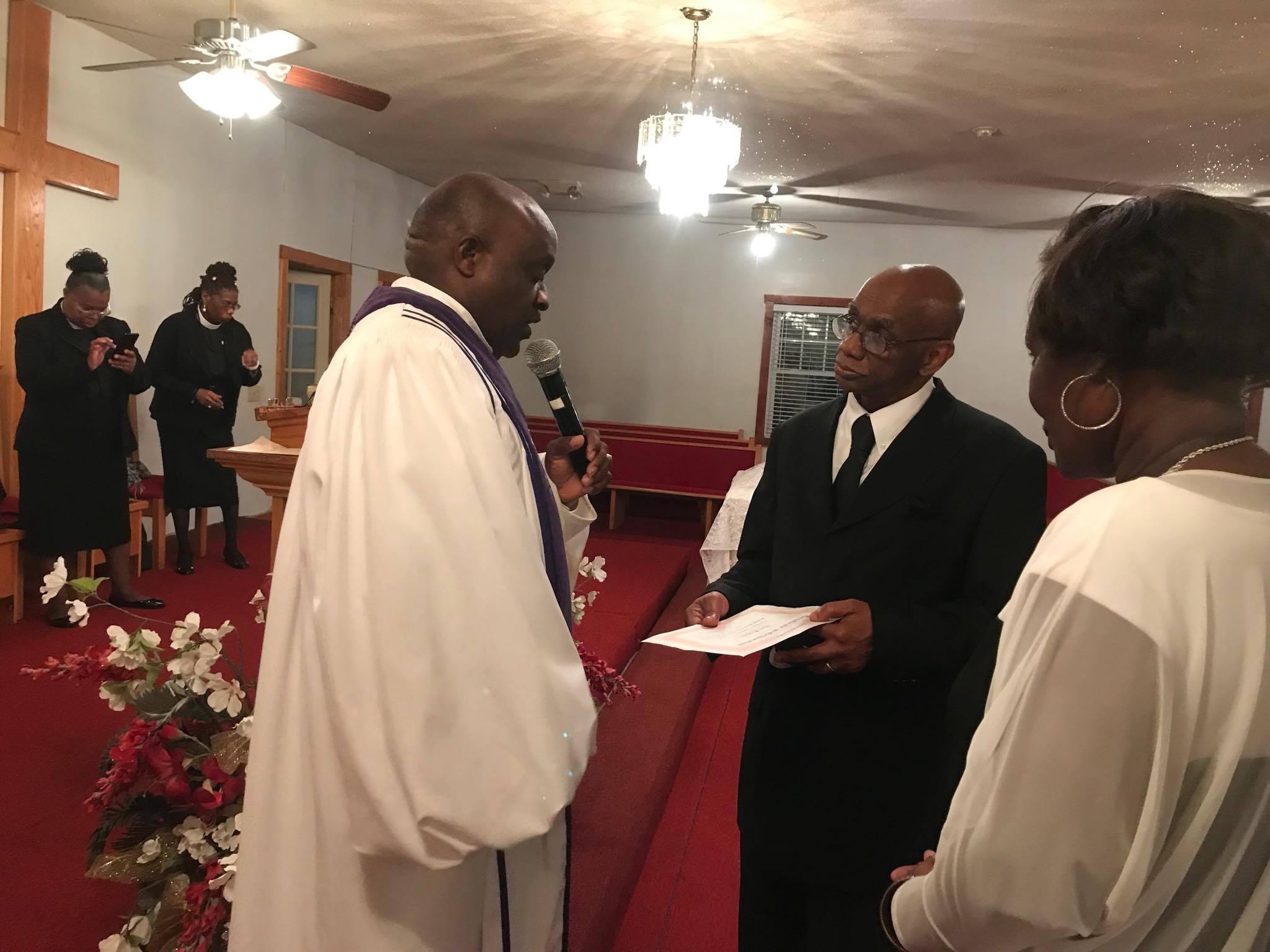 Pastor Giving Ordination Certificate