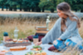 Girl having a picnic, luxury getaways Wales