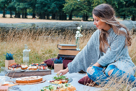 Girl having a picnic, luxury getaways Wales