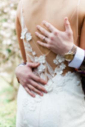 Groom embracing bride, weddings at Tredilion Park