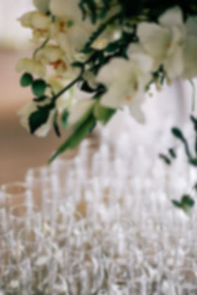 White roses placed over champagne flutes, wedding venues in South Wales