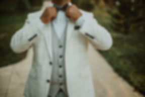 Man wearing white suit, private party hire Wales