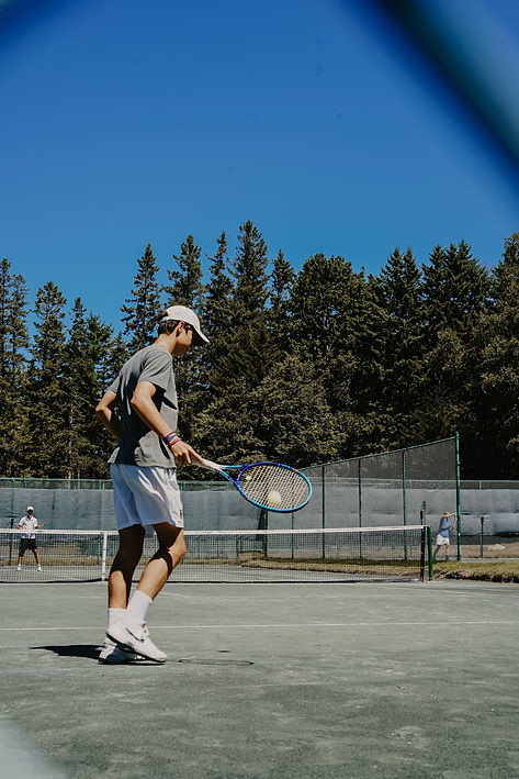 Playing tennis, Short Breaks Monmouth