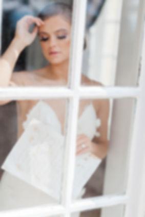 Bride in window, wedding venues South Wales