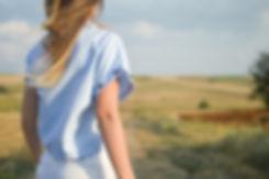 Back of girl on country walk, weekend breaks in Wales