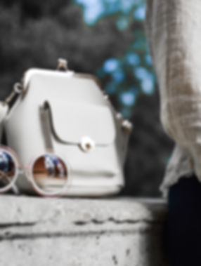 Cream handbag and sunglasses, luxury event hire South Wales
