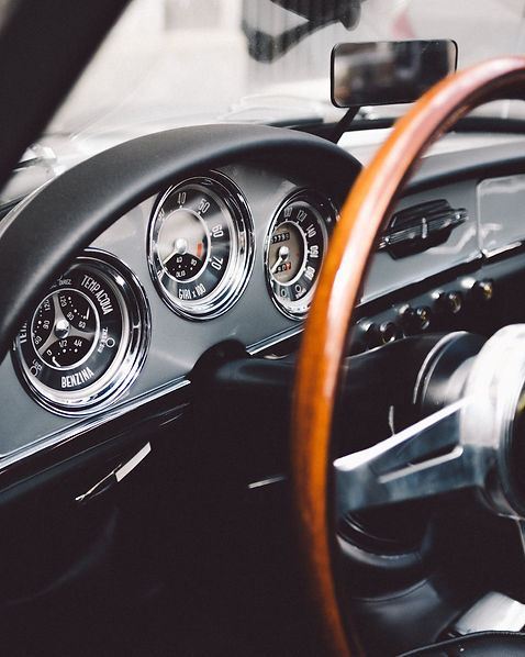 Italian classic car dashboard, luxury chauffeuring Monmouthshire