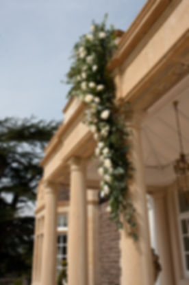 Floral drape on outdoor pillar, wedding venues South Wales
