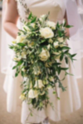Bridesmade holding bouquet of flowers, wedding venues in Wales