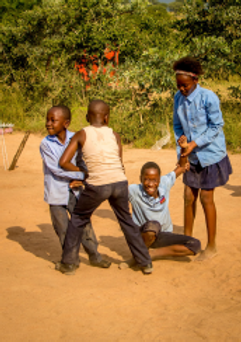africa travel volunteer gap year community work animal conservation wildlife nature kids playing