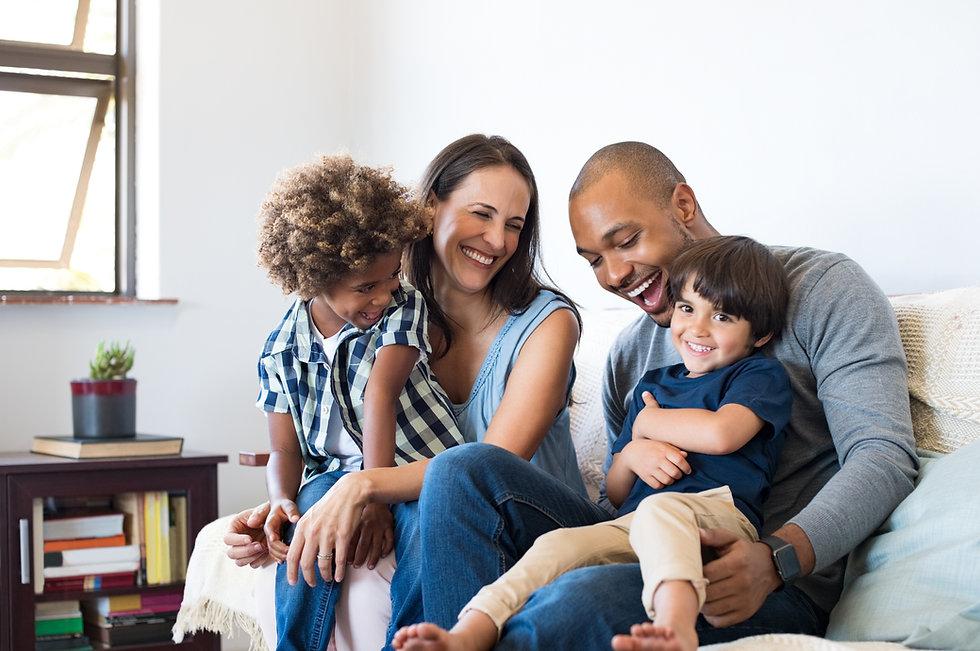 Happy multiethnic family sitting on sofa