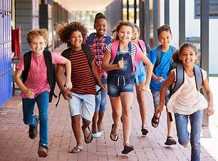 school-kids-running-elementary-hallway-f