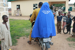 """""""It is our collective responsibility to keep everyone healthy"""" A community health worker on her way"""