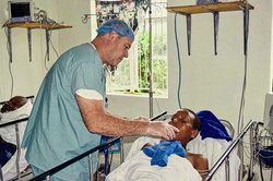 A physician tending to his patient at Kenya Relief mission hospital in Migori, Kenya