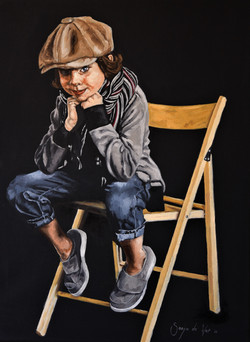 Boy on wooden chair