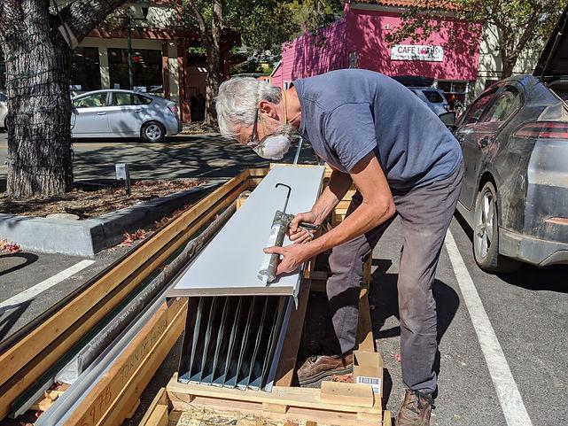 Bruce working on Bus Shelter roof 1.jpg
