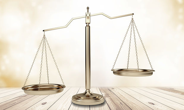Justice Scales and books and wooden gave