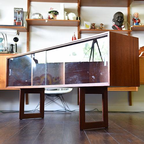 Danish teak top hutch, glass cabinet with rare sleek base.