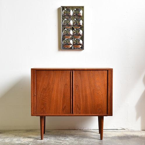 Iconic Kai Kristiansen's compact cabinet, tambour doors