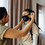mom-putting-mask-on-daughter.png