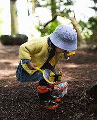 Toddler_girl_exploring_outdoors.jpg