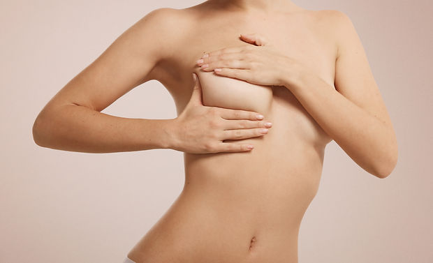 woman-checking-her-breast-for-breast-can
