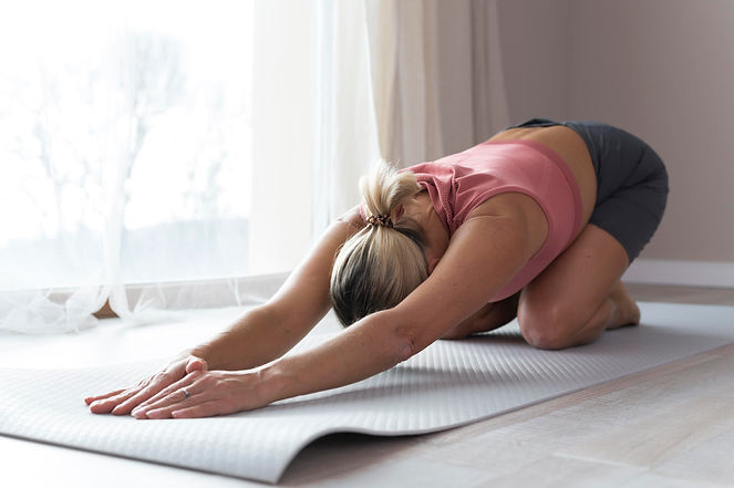 woman-doing-fitness-exercises-and-stretc