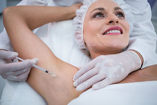 doctor-injecting-woman-on-her-arm-pits.j
