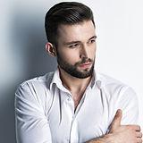 handsome-man-in-white-shirt-posing-attra