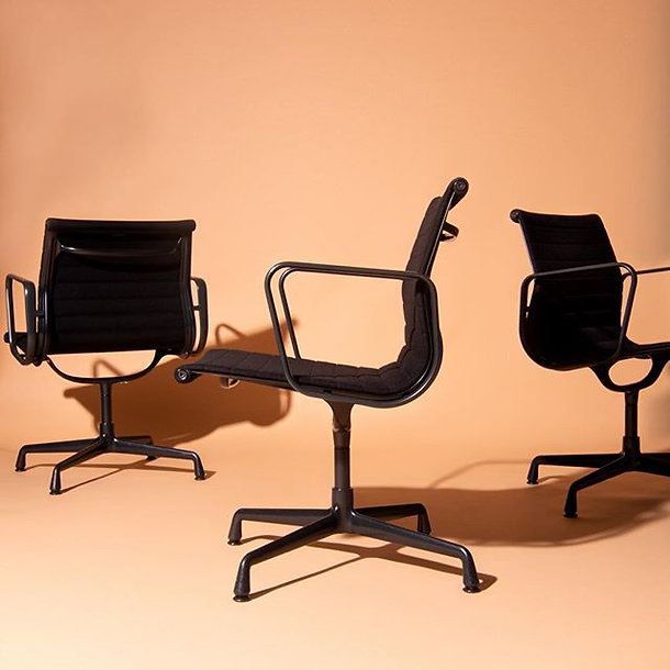 Black Eames chairs EA108 designed by Cha