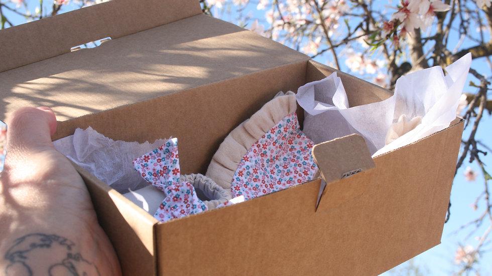 Zapatito arena lazo flores + cuello