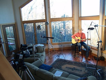 Dan recording in his mountain home