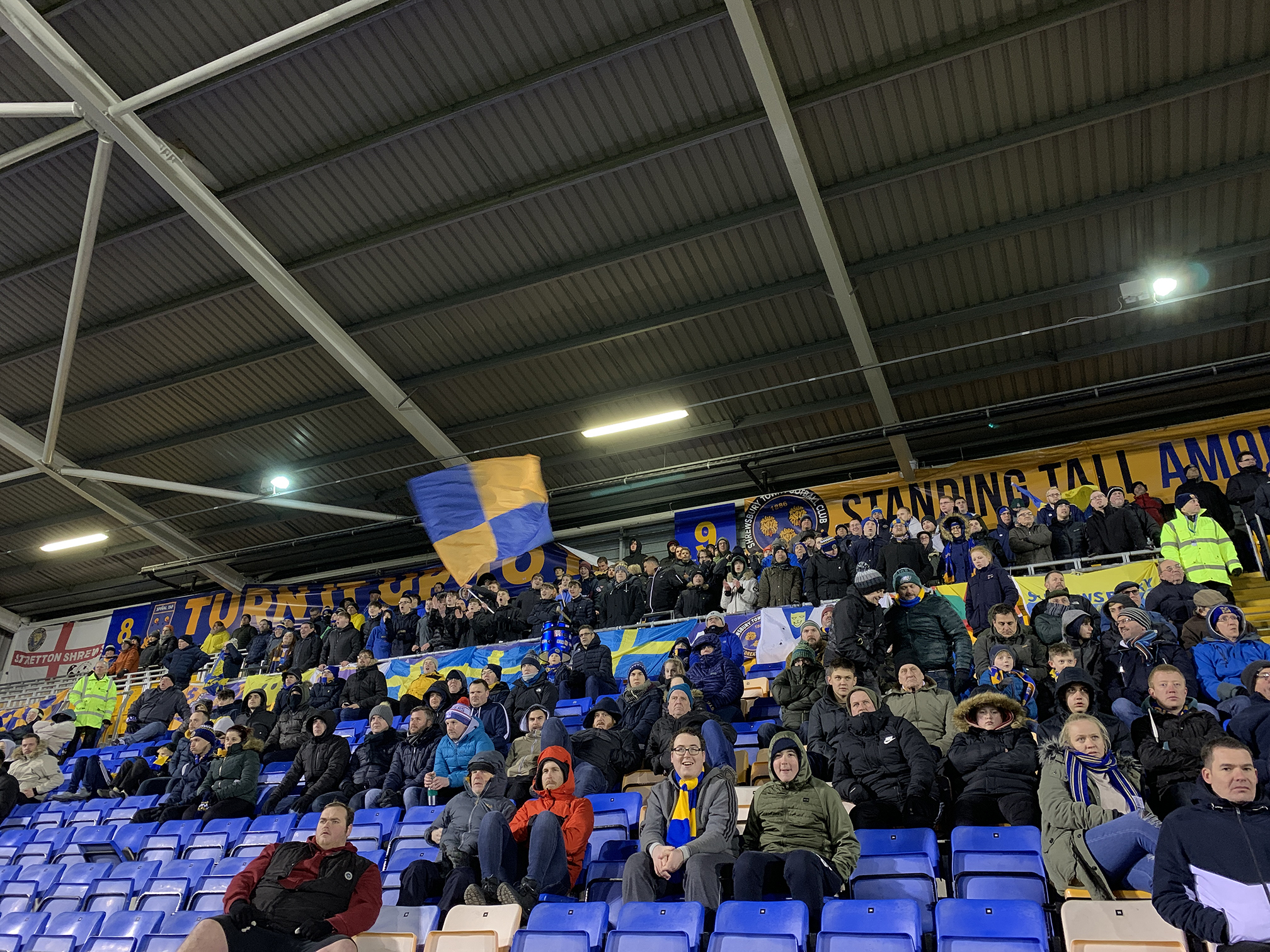 Town supporters cheering on the team
