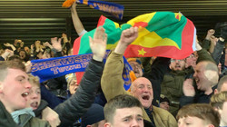 Town fan celebrate at Anfield