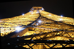 Looking straight up at the Eiffel Tower,