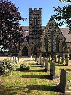 church entrance and graves.jpg