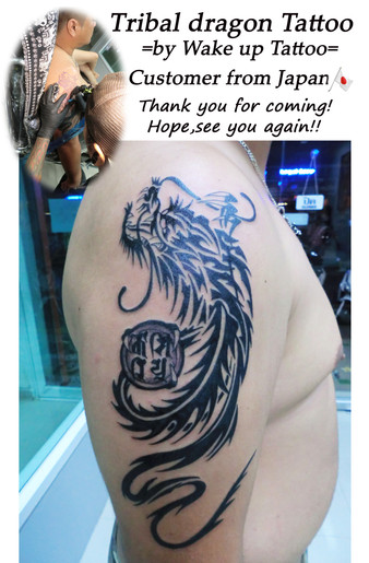 Tribal dragon Tattoo by Wake up Tattoo Phuket