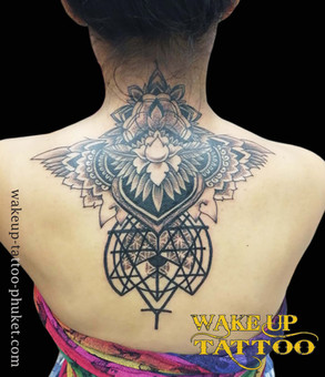 Geometric neck & back piece with mandala patterns by Wake up Tattoo Phuket