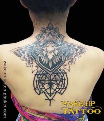 Geometric neck & back piece with mandala patterns by Wake up Tattoo Phuket