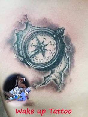 compass tattoo by Wake up Tattoo Phuket