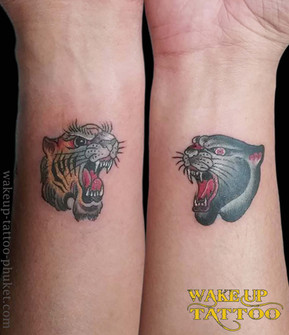 Old School tiger and panther tattoo by Wake up tattoo Phuket