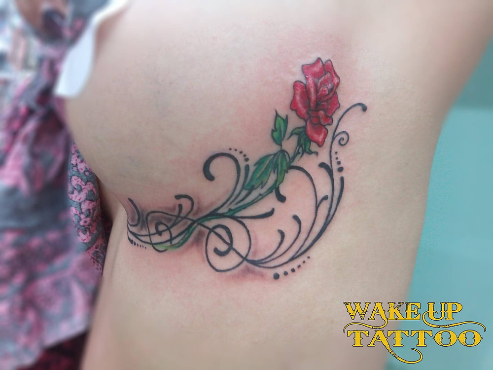 Under chest Rose Tattoo by Wake up Tattoo Phuket